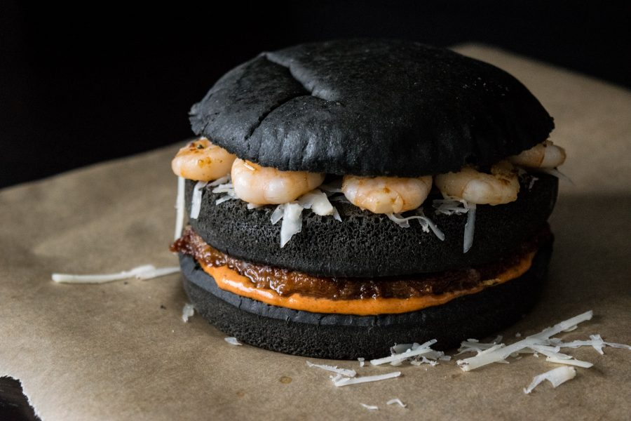 black burger with chorizo patty, machego cheese and shrimps